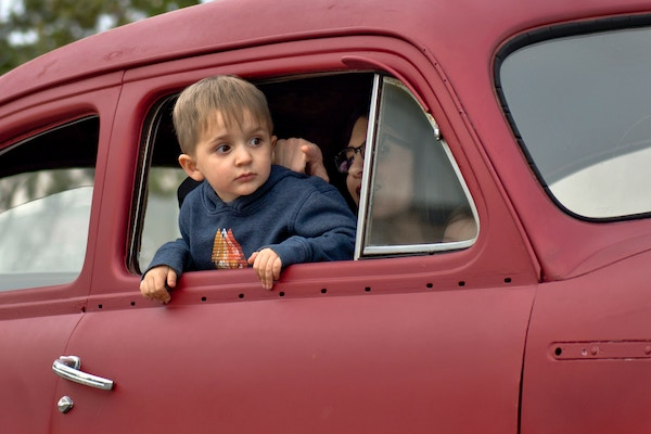 toddler in car
